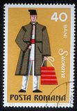Stamp printed in the Romania, shows the traditional dress of men in the region Suceava. A stamp printed in the Romania, shows the traditional dress of men in the Stock Photography