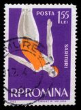 Stamp printed in the Romania shows Woman Diver, Jumping into Water from Platform Stock Image