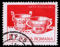 Stamp printed in Romania shows Wooden tubs from Hunedoara and Suceava. A stamp printed in Romania shows Wooden tubs from Hunedoara and Suceava, circa 1982 Stock Images