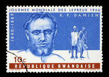 A stamp printed in Rwanda shows Father Joseph Damien, World Leprosy Day Stock Images