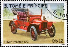 Postage stamp printed in S.Tome e Principe shows image of the retro car Rover Phaeton 1907 year of release. Stamp printed in S.Tome e Principe shows image of the Stock Photography
