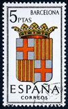 Stamp printed in Spain dedicated to Arms of Provincial Capitals shows Barcelona. SPAIN - CIRCA 1962: A stamp printed in Spain dedicated to Arms of Provincial royalty free stock photo