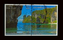 A stamp printed in Thailand shows an image of Beautiful ocean views with mountain at Hong Island, Krabi. BANGKOK, THAILAND. – 02/08/2018 - A stamp printed in Royalty Free Stock Photos