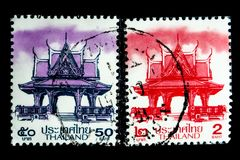 A stamp printed in Thailand shows an image of Thai Pavilion in purple and red color. BANGKOK, THAILAND. – 02/08/2018 - A stamp printed in Thailand shows an Royalty Free Stock Images