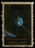 Stamp printed in United Arab Emirates UAE shows Explorer 17 satellite. A stamp printed in United Arab Emirates UAE shows Explorer 17 series satellites, circa Royalty Free Stock Images