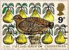 A stamp printed in United Kingdom shows Partridge in a Pear Tree royalty free stock images