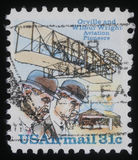 Stamp printed in USA showing Wright brothers and Wright Flyer I plane Royalty Free Stock Photo