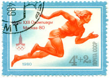 A Stamp Printed By USSR Games Olympics, Moscow - 80, Circa 1980. USSR - CIRCA 1980: A Stamp Printed By USSR Shows Olympic Emblem And Run, Games Olympics, Moscow stock image