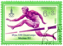 A Stamp Printed By USSR Games Olympics, Moscow - 80, Circa 1980. USSR - CIRCA 1980: A Stamp Printed By USSR Shows Olympic Emblem And Running With Obstacles stock photo