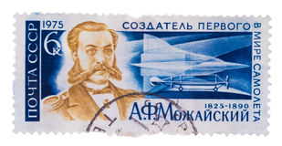 Stamp printed in the USSR, shows . Mozhajskij - creator the f. A stamp printed in the USSR, shows A. Mozhajskij - creator the first plane, circa 1975 Stock Photos