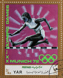 A stamp printed in Yemen Arab Republic shows steeplechase, Olympics in Munich. Circa 1972 Royalty Free Stock Photos