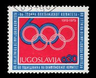 Stamp printed by Yugoslavia is dedicated to the 60th anniversary of the Olympic Committee Royalty Free Stock Photo