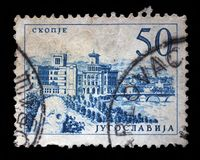 Stamp printed in Yugoslavia shows a Bridge at Skopje. With inscription `Skopje`, from series `Industrial Progress` circa 1958 royalty free stock images