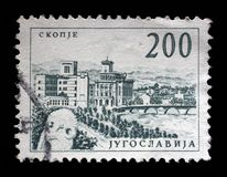 Stamp printed in Yugoslavia shows a Bridge at Skopje. With inscription `Skopje`, from series `Industrial Progress` circa 1958 royalty free stock image