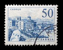 Stamp printed in Yugoslavia shows a Bridge at Skopje. With inscription `Skopje`, from series `Industrial Progress` circa 1958 stock images