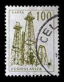 Stamp printed in Yugoslavia shows a Oil derricks. Nafta, with the same inscription, from series `Industrial Progress` circa 1958 Stock Photos