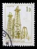 Stamp printed in Yugoslavia shows a Oil derricks. Nafta, with the same inscription, from series Industrial Progress circa 1966 Royalty Free Stock Images