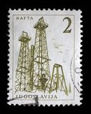 Stamp printed in Yugoslavia shows a Oil derricks. Nafta, with the same inscription, from series `Industrial Progress` circa 1958 Royalty Free Stock Image