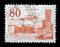 Stamp printed in Yugoslavia shows Sarajevo railway station and obelisk, Bosnia and Herzegovina Royalty Free Stock Images