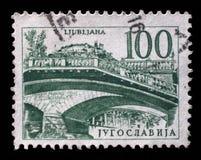Stamp printed in Yugoslavia shows Triple bridge, Ljubljana. Circa 1958 stock photos