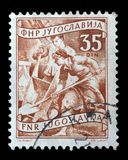 Stamp printed in Yugoslavia shows working at a construction site Royalty Free Stock Photography
