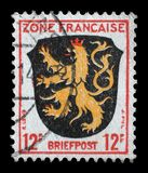 Stamp printed in the Zone Francaise, Germany shows Coat of Arms of Palatinate District Royalty Free Stock Photos