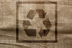 Stamp on sackcloth industrial recycling symbol Royalty Free Stock Photography
