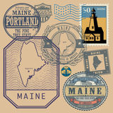 Stamp set with the name and map of Maine Royalty Free Stock Image