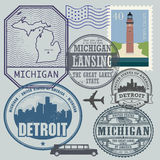 Stamp set with the name and map of Michigan Royalty Free Stock Images