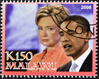Stamp shows Barack Obama with Hillary Clinton. MALAWI - CIRCA 2008: A stamp printed in Malawi shows the 44th President of United States of America, Barack Obama stock photo