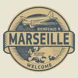 Stamp or tag with airplane and text Welcome to Marseille, France. Grunge rubber stamp or tag with airplane and text Welcome to Marseille, French Republic in Royalty Free Stock Photography