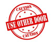 Use other door. Stamp with text use other door inside,  illustration Stock Photography