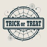 Stamp with Trick or Treat text. And spider net. Round shape Stock Images