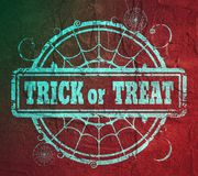 Stamp with Trick or Treat text. And spider net. Round shape. Grunge distress texture Stock Photos