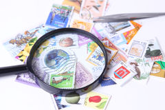 Stamp under magnifier Royalty Free Stock Images