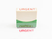 Stamp with urgent in red ink Royalty Free Stock Photography