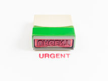 Stamp with urgent in red ink Royalty Free Stock Image