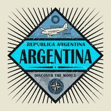 Stamp or vintage emblem text Argentina, Discover the World. Stamp or vintage emblem with airplane, compass and text Argentina, Discover the World, vector stock illustration