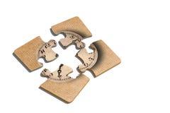 Stampa antiquata dell'orologio sui pezzi di puzzle Fotografia Stock Libera da Diritti