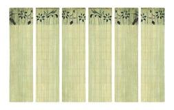 Stampa del fiore dell'inchiostro sull'insieme di carta di bambù della bandiera Fotografie Stock
