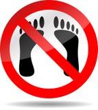 Stampa del piede di divieto Fotografie Stock Libere da Diritti