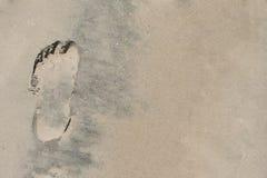 Stampa del piede sulla sabbia Fotografia Stock