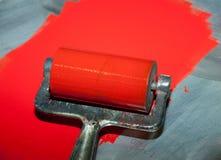 Stampa del rullo con l'inchiostro rosso fotografia stock libera da diritti