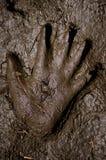 Stampa della mano in fango Fotografia Stock