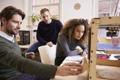 Stampatore In Design Studio di Team Of Designers Working With 3D Fotografia Stock