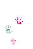 Stampe della mano dei bambini sulla parete bianca Fotografie Stock