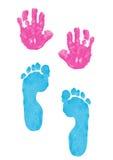 Stampe della mano e del piede del bambino fotografia stock