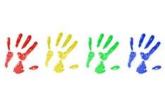 Stampe della mano in vernice Immagine Stock