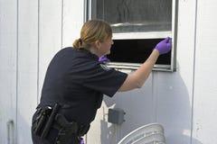 Stampe della spolverata dell'ufficiale di polizia Fotografia Stock Libera da Diritti