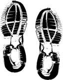 Stampe nere della scarpa su bianco Immagini Stock Libere da Diritti